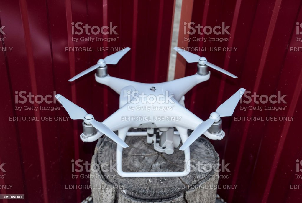 Quadrocopters DJI Phantom 4 on a wooden stump stock photo