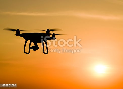 istock Quadrocopters silhouette against the background of the sunset 868651584