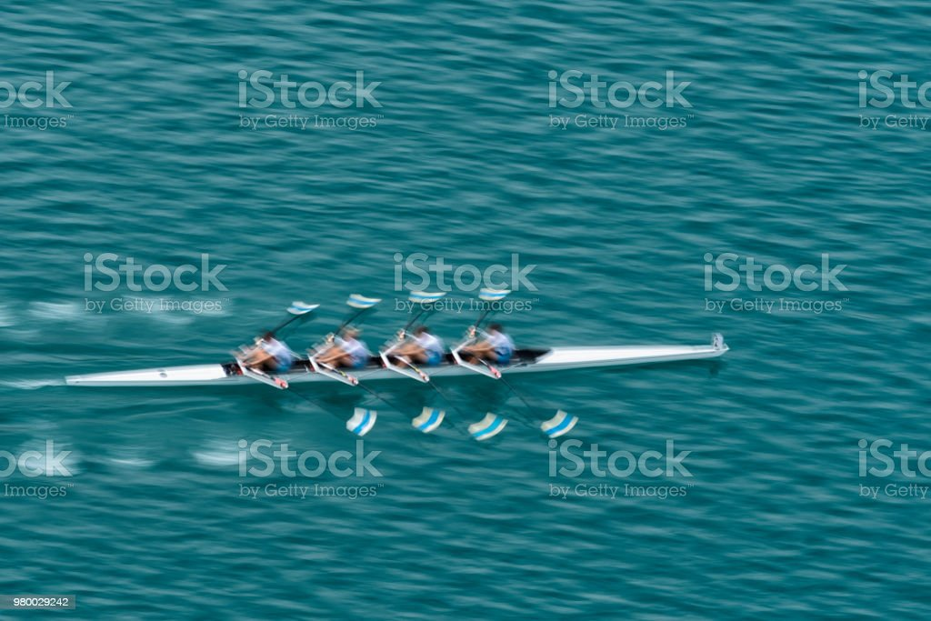 Quadruple Scull Rowing Team Practicing, Blurred Motion stock photo