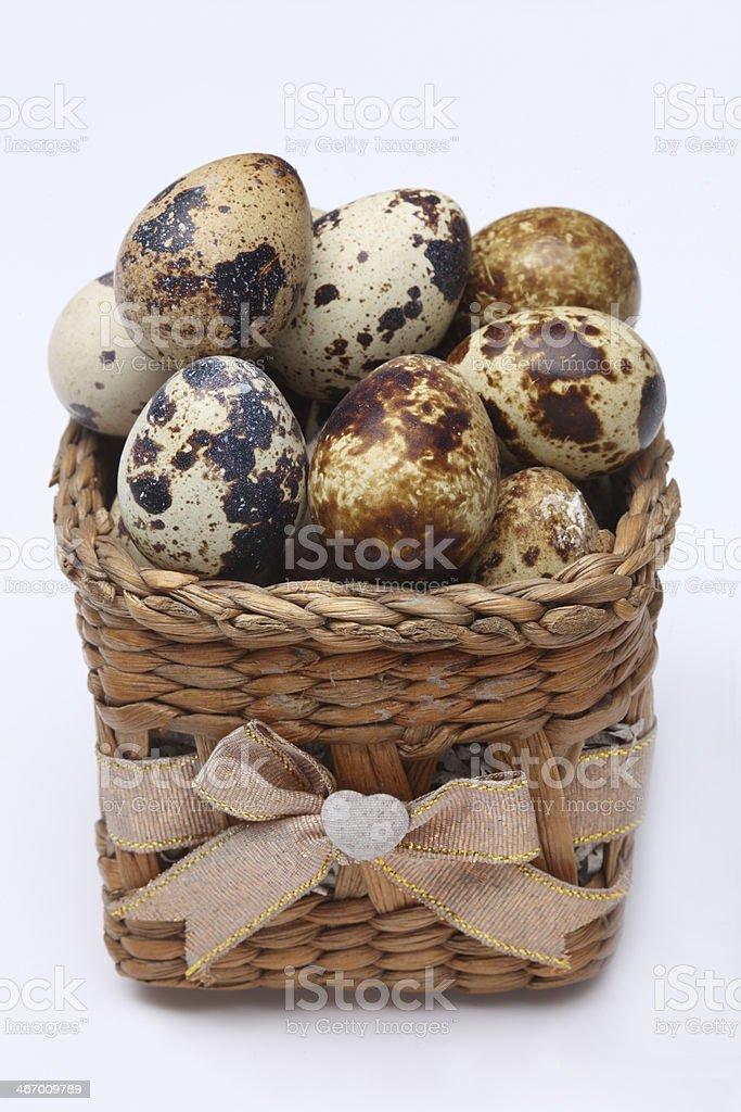 Quail eggs in basket royalty-free stock photo