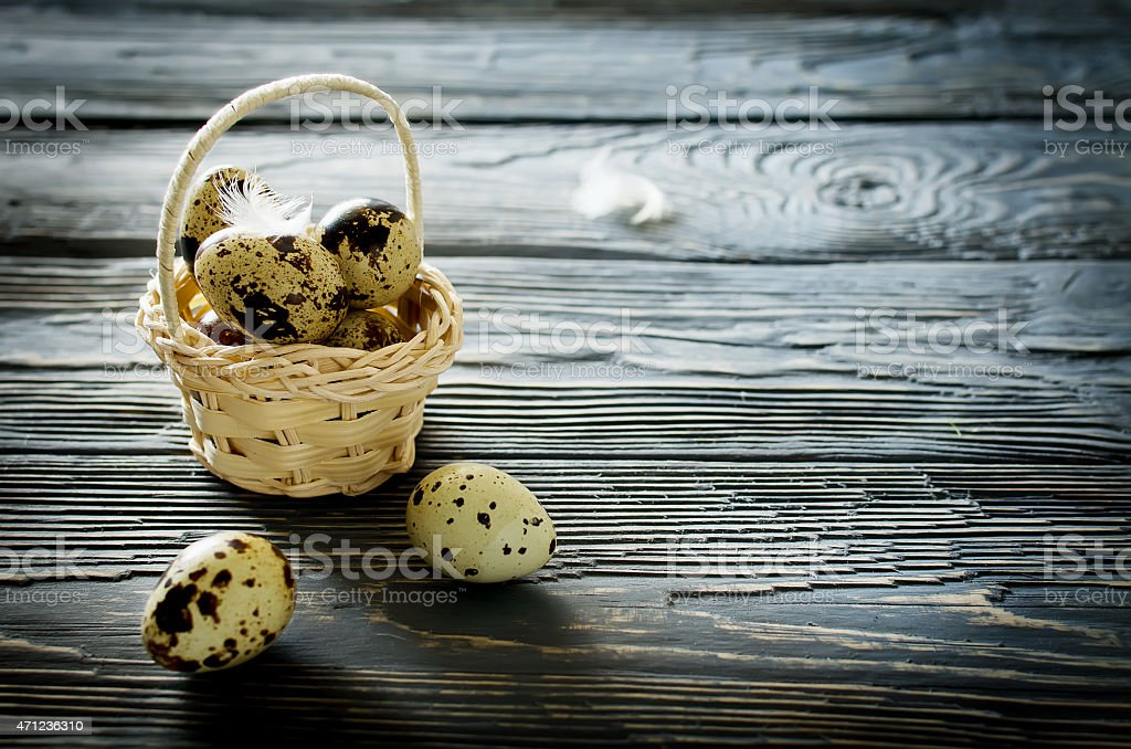 Quail eggs in the basket stock photo