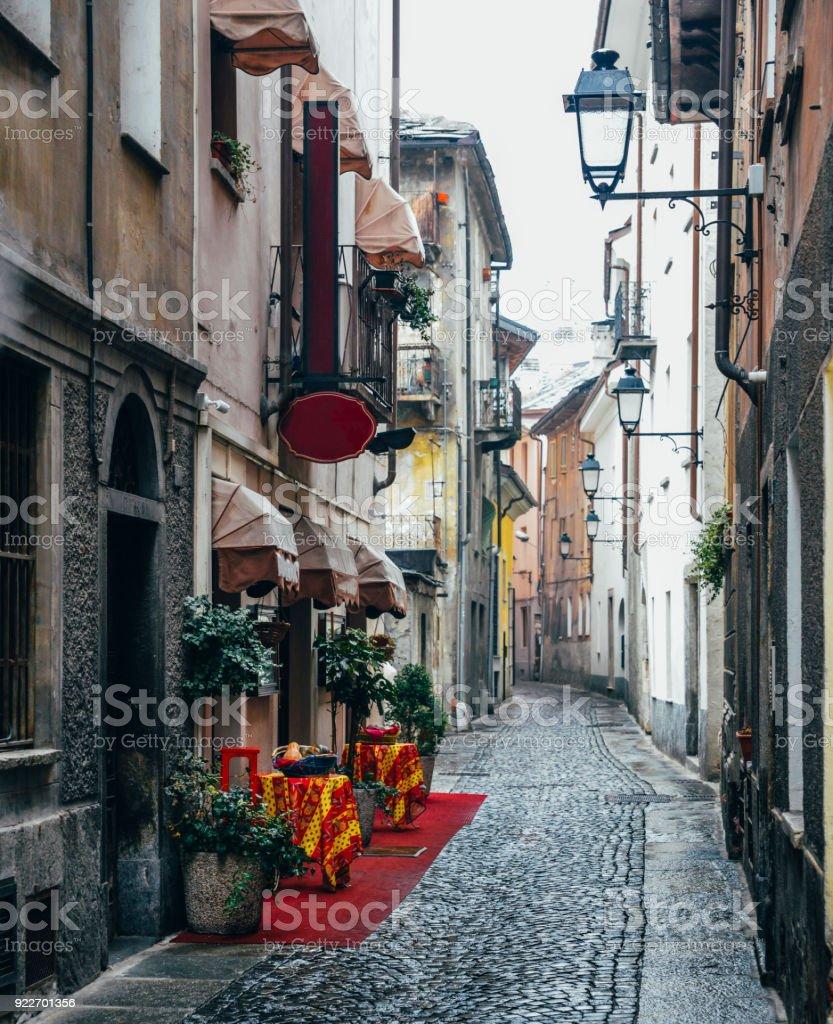 Arte Del Rustico Aosta quaint cobblestone alleyway in aosta italy with inviting red