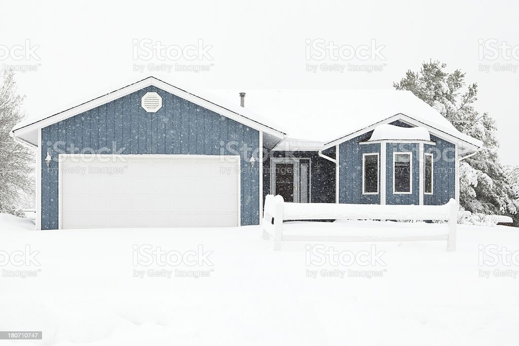 Quaint House During Winter Snowstorm royalty-free stock photo