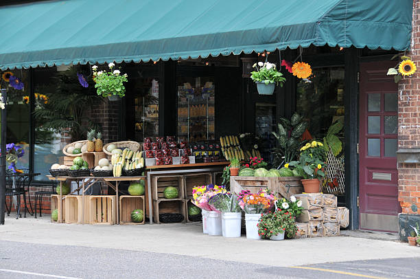 Quaint Neighborhood Market A quaint neighborhood greengrocer grocer stock pictures, royalty-free photos & images