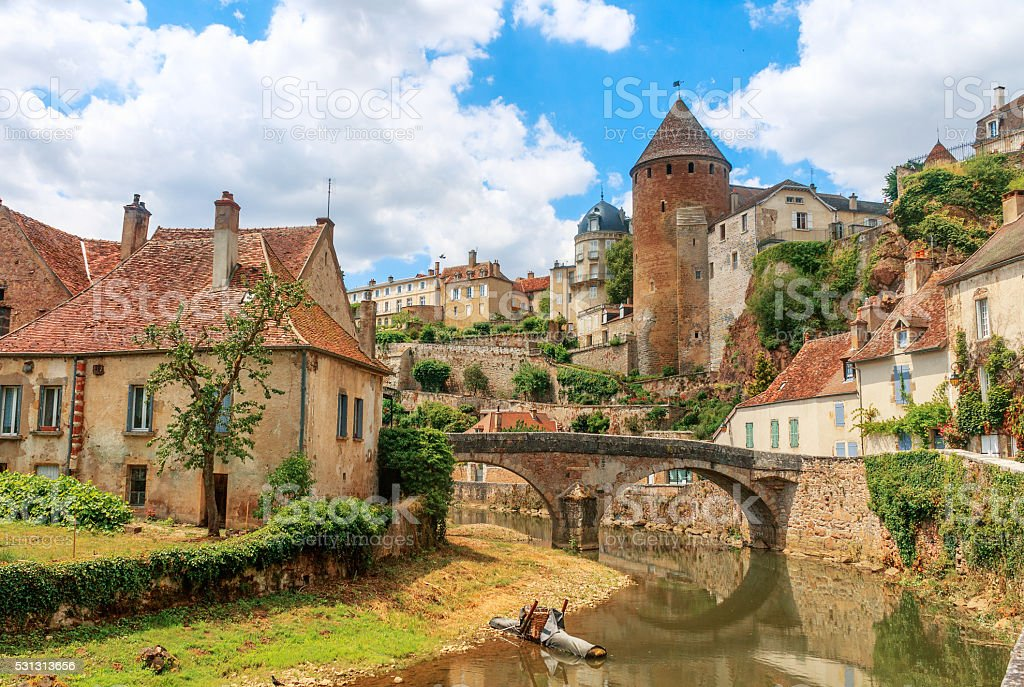 Quaint river through the medieval town of Semur en Auxois stock photo