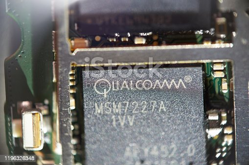 Saransk, Russia - December 16, 2019: A Qualcomm Snapdragon MSM7227A SoC on smartphone circuit board.