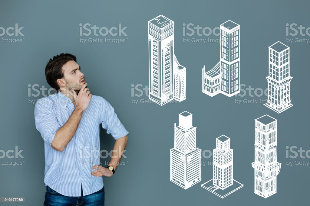 Qualified architect thinking while working at constructing skyscrapers stock photo