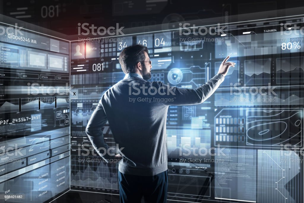 Qualified programmer pointing to the screen while analyzing the new information stock photo