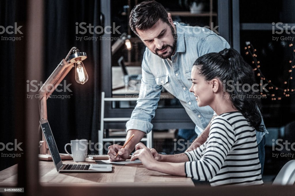 Qualified responsible boss staying and giving advices. stock photo