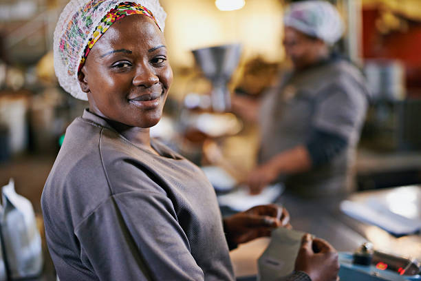 Quality assured Portrait of a worker in a coffee packaging and distribution warehousehttp://195.154.178.81/DATA/i_collage/pi/shoots/784288.jpg hair net stock pictures, royalty-free photos & images
