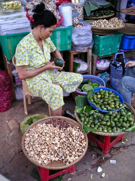 quality control at the hanoi street market - mcdermp stock photos and pictures
