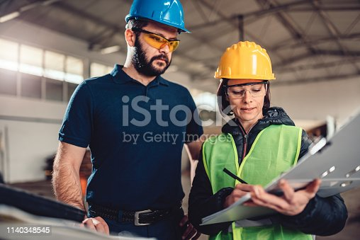 istock Quality Control Process Inspector writing a report 1140348545