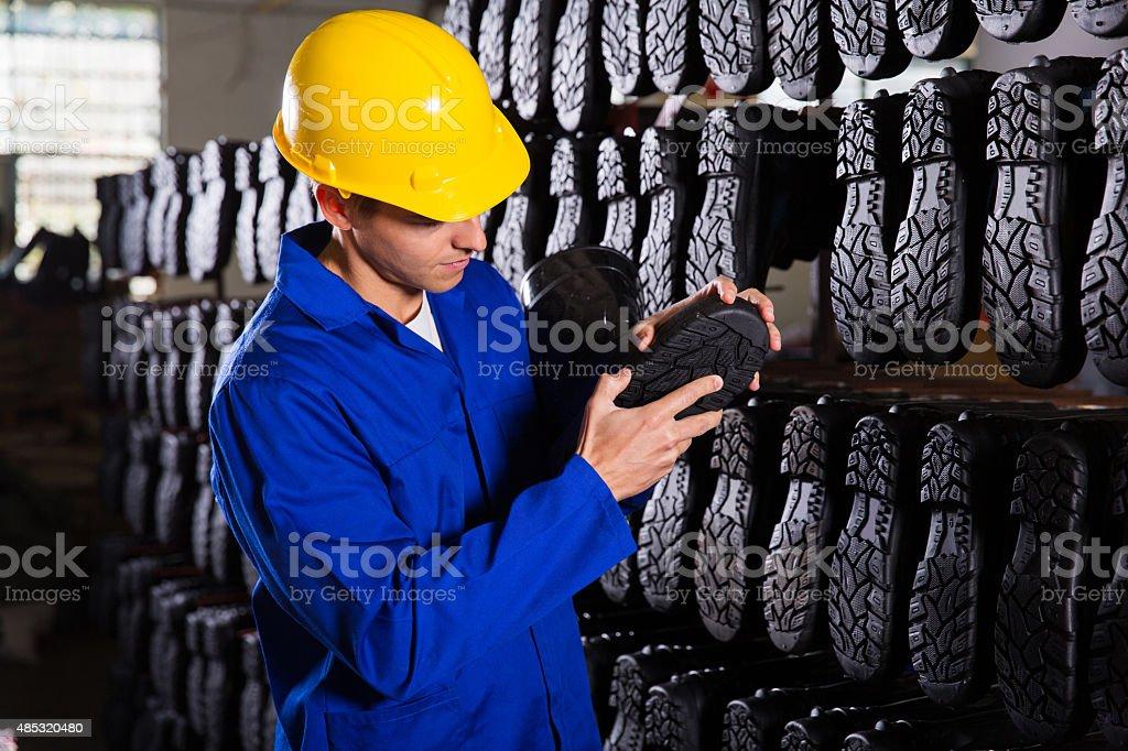 Contrôleur qualité contrôle-bottes en caoutchouc - Photo
