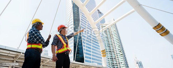 976560476 istock photo Quality engineers or construction teamwork. Safety concern for engineering or building work site or plant. Wearing helmet and protective equipment can safe workers. Banner background with copy space 1170209258