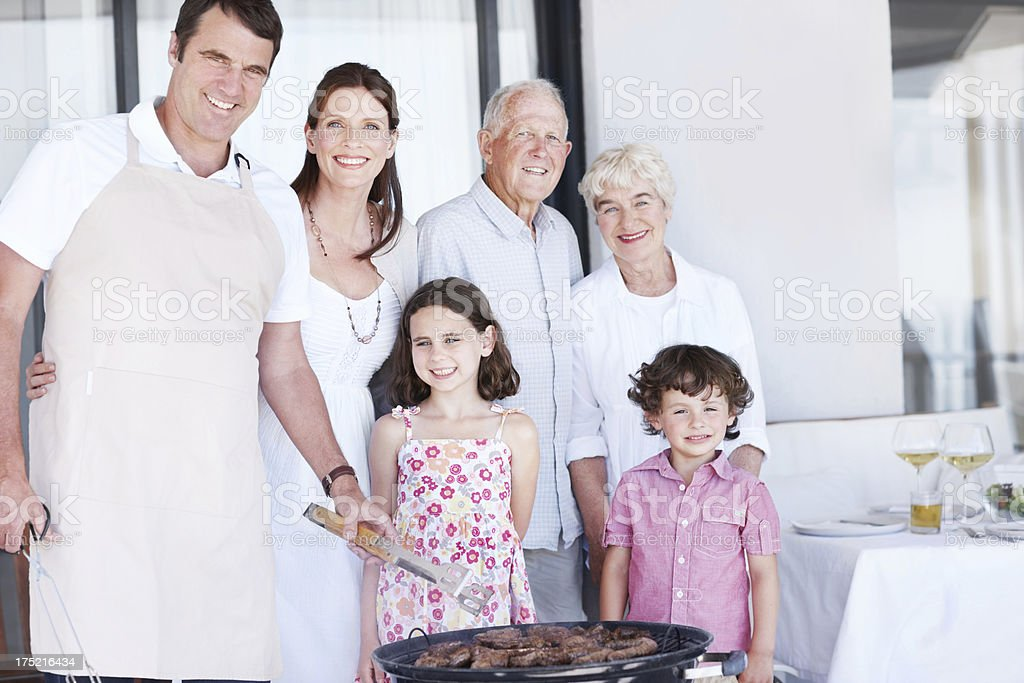 Quality family time over a tasty barbecue royalty-free stock photo