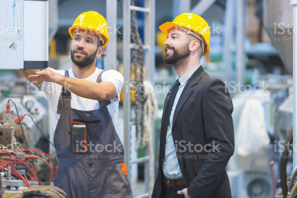 Quality inspector at factory stock photo