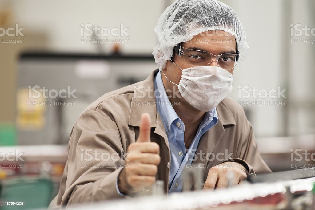 Quality Inspector Showing Thumb up stock photo