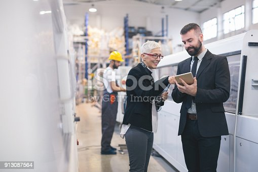 istock Quality inspectors at the factory 913087564