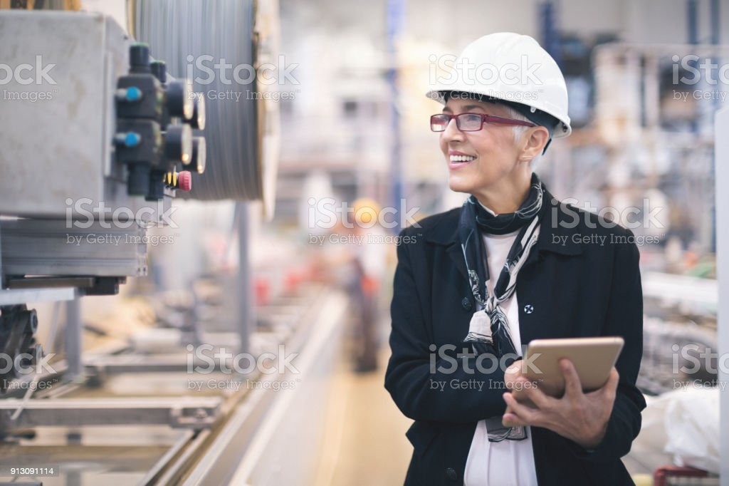Quality inspectors at the factory stock photo