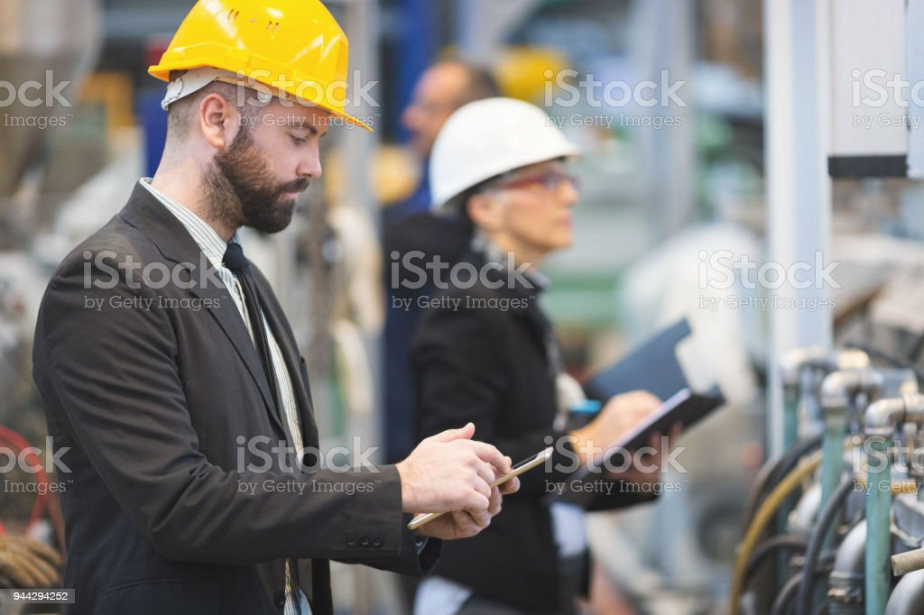 Quality inspectors in high tech factory stock photo