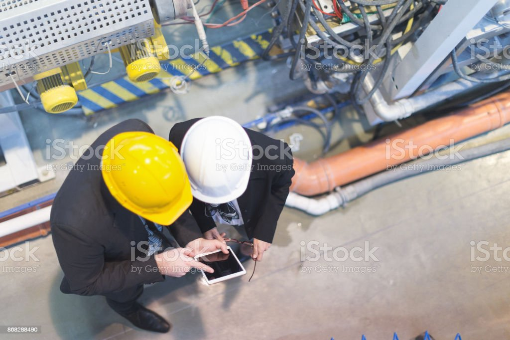 Quality inspectors team at factory stock photo