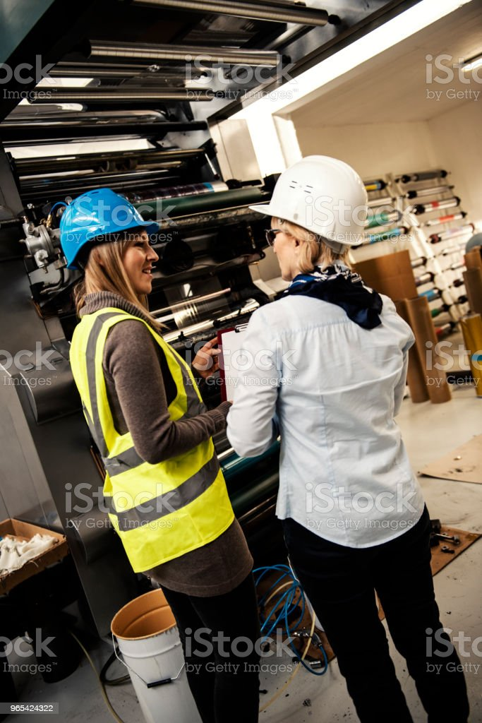 Quality inspectors team at factory royalty-free stock photo