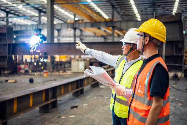 Quality inspectors working in a steel factory stock photo