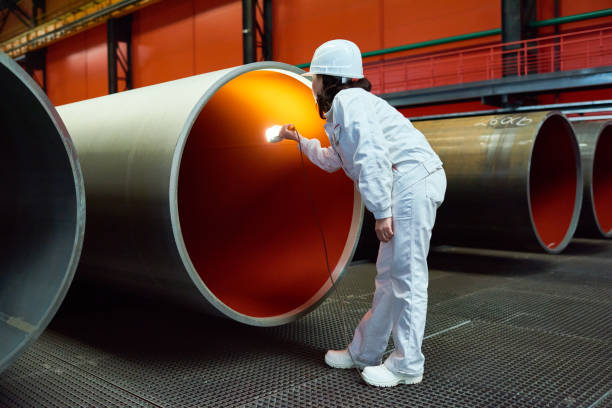 quality manager working at tube rolling factory - metallurgy stock photos and pictures