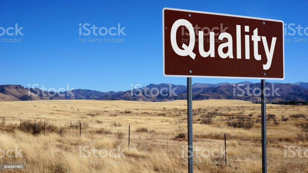 Quality road sign stock photo