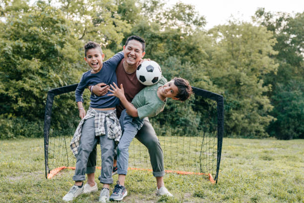 Quality time outdoor - parents and kids sport activities together stock photo