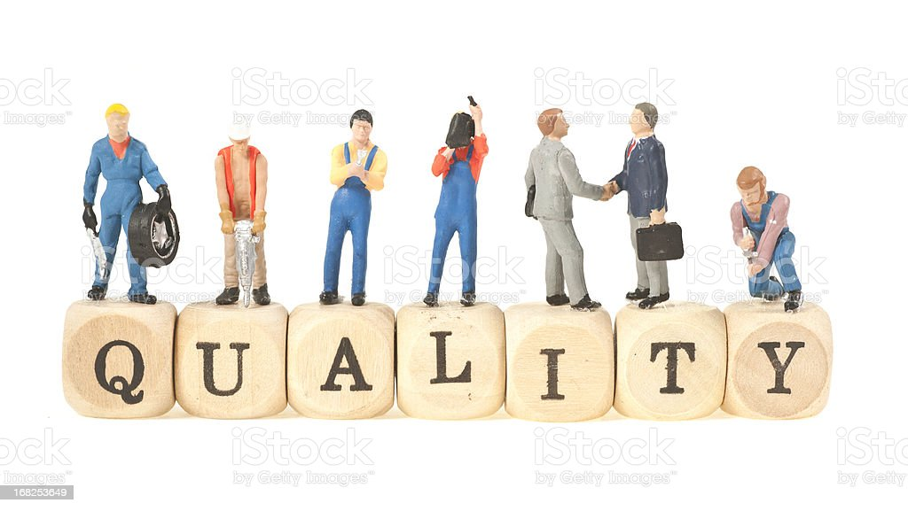 quality word with figurines stock photo