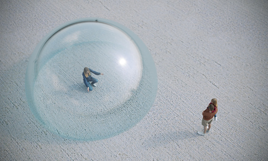 A mother looking to her family in glass dome bubble, symbolizing quaratine, social distance concept. ( 3d render )