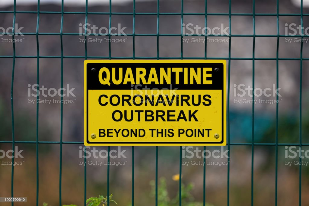 """Quarantine - Coronavirus beyond this point Red an white warning sign on a fence stating in """"Quarantine - Coronavirus beyond this point"""" with a blank space underneath. Black Color Stock Photo"""