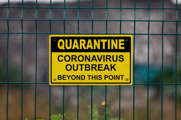 "Quarantine - Coronavirus beyond this point Red an white warning sign on a fence stating in ""Quarantine - Coronavirus beyond this point"" with a blank space underneath. quarantine stock pictures, royalty-free photos & images"