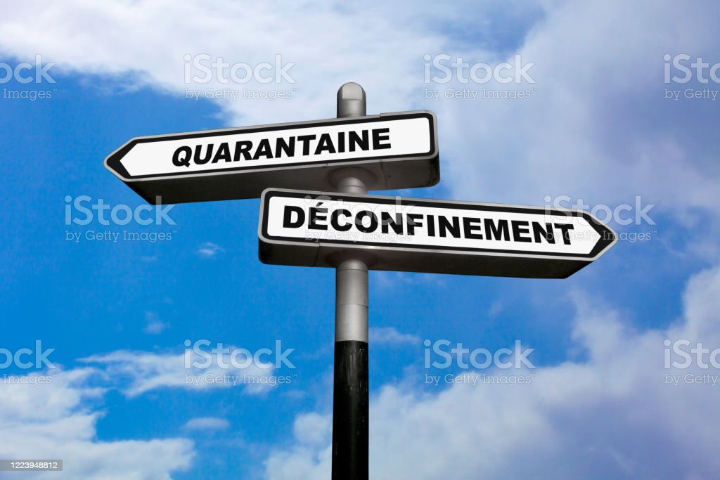 Quarantine or Deconfinement - French directional sign - Royalty-free Arrow Symbol Stock Photo