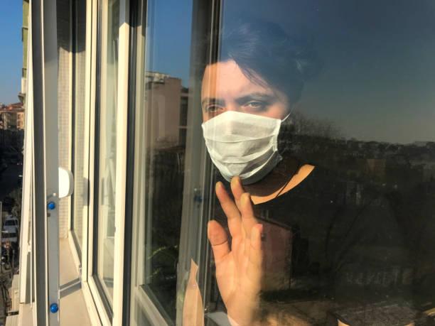 quarantine - hand on glass covid foto e immagini stock