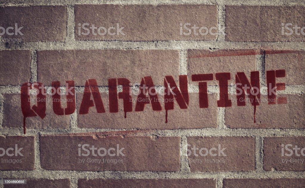 """Quarantine"" Stencil Spray-Painted on Brick Wall - Royalty-free Brick Wall Stock Photo"
