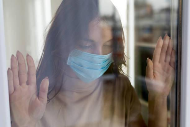 Quarantine woman at home stock photo