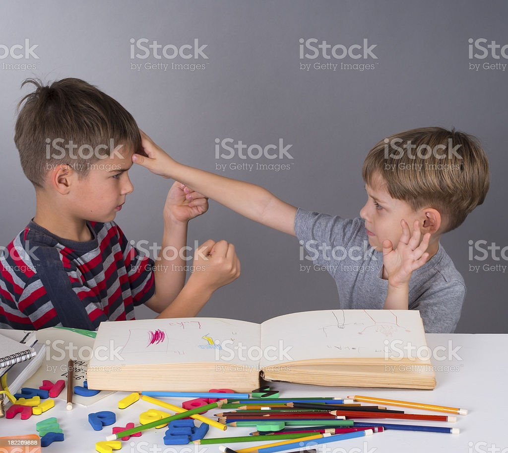 quarell between boys in the school stock photo