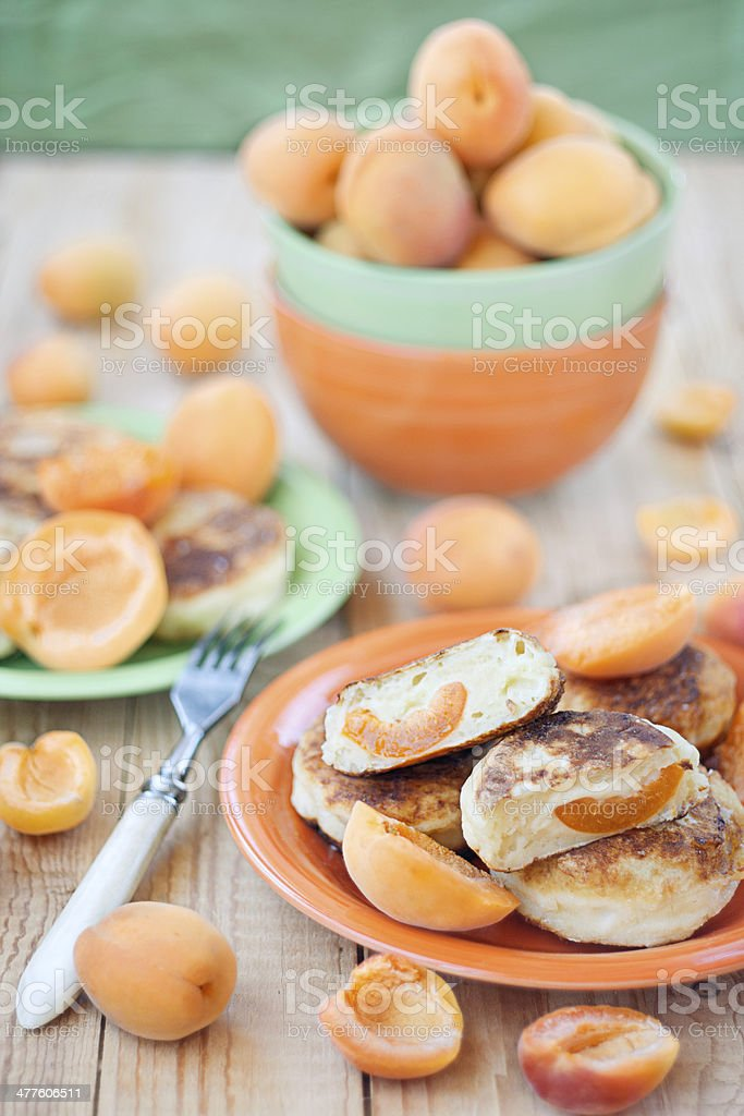 Quark pancakes with apricots royalty-free stock photo
