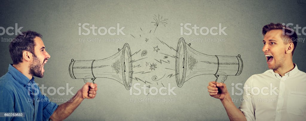 Quarrel between two men screaming at each other in megaphone stock photo