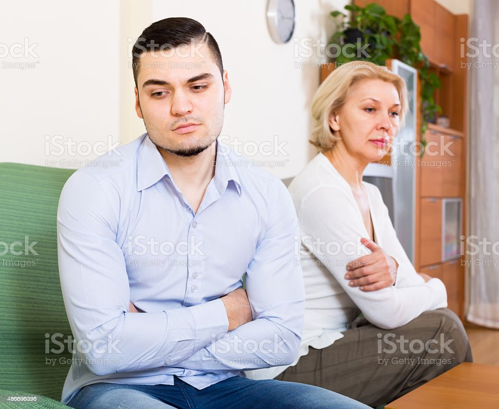 Quarrel of adult son and senior mother stock photo