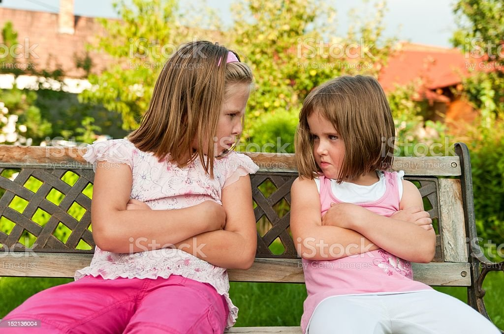 Quarrel - offended sisters royalty-free stock photo