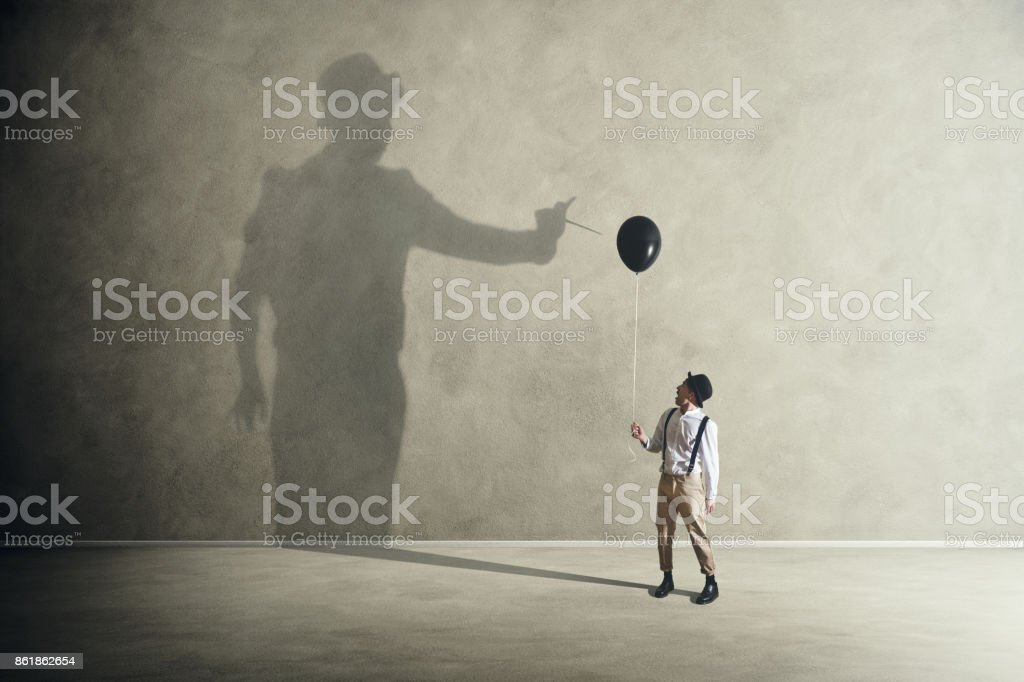Quarrel with its shadow stock photo