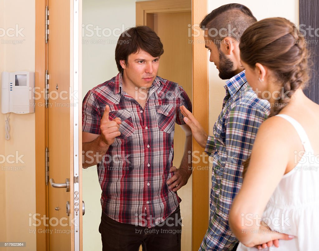 Quarrel with neighbour indoor stock photo