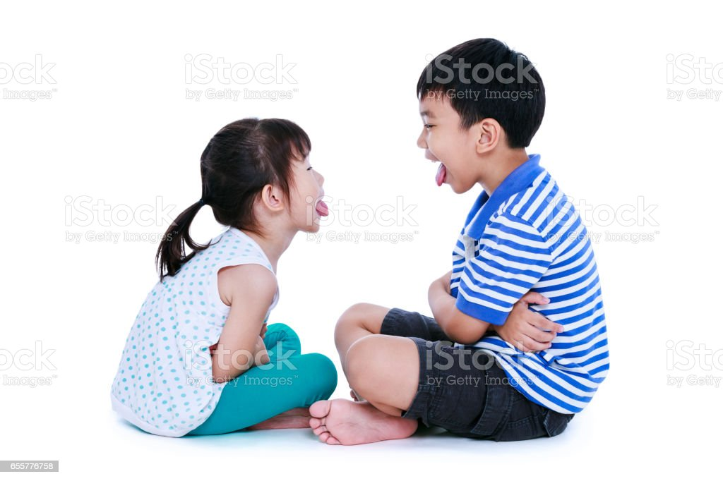 Quarreling conflict between brother and sister. Isolated on white. stock photo