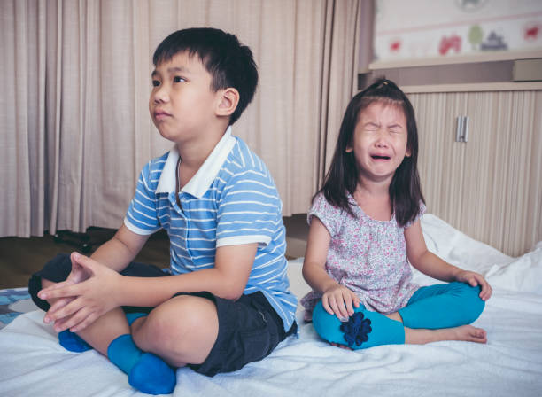 Quarreling conflict of children. Relationship difficulties in family concept. stock photo