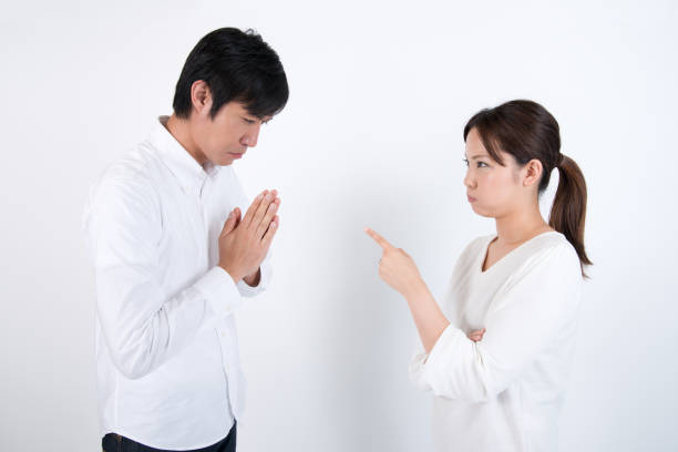 quarreling couple family image on white background, without heavy processing but carefully and naturally retouched on skin clothing items and so on, very clean and neat image overall, photographed in ISO 100 asian couple arguing stock pictures, royalty-free photos & images