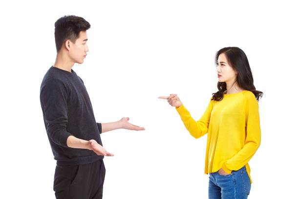 quarreling young asian couple quarreling young asian couple blaming each other, isolated on white background. asian couple arguing stock pictures, royalty-free photos & images