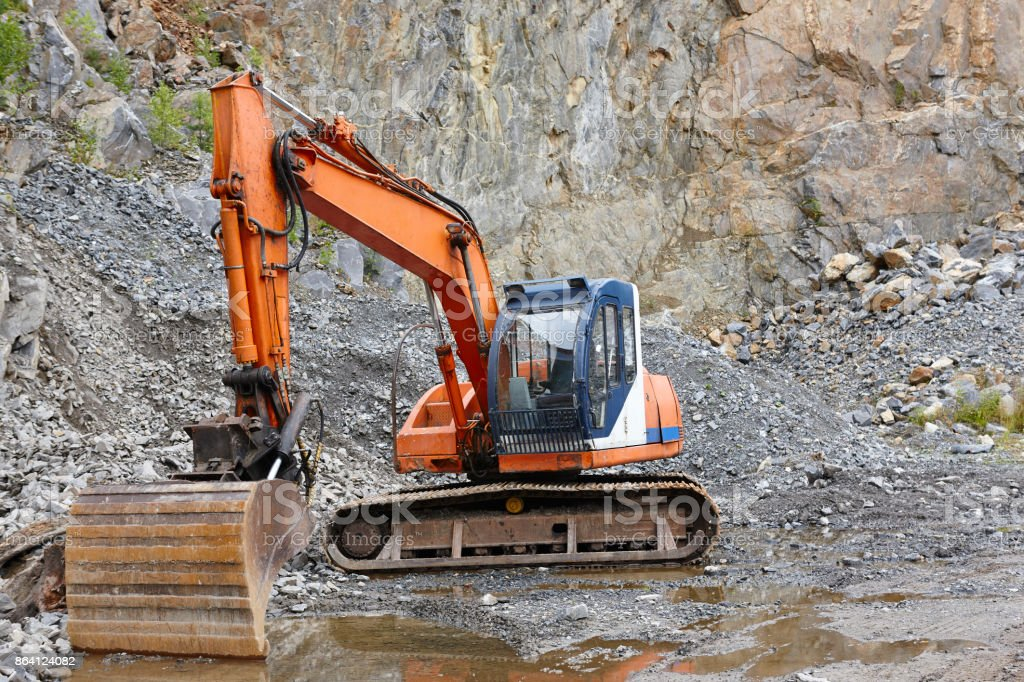 Quarry aggregate with heavy duty machinery. Construction industry. stock photo